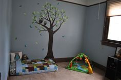Montessori nursery. Would definitely add mirror by bed & mobile above