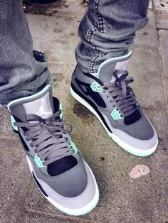 "Air Jordan 4 ""Green Glow"" on feet"