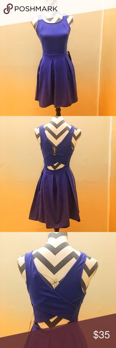 Express Open Back Skater Dress XS Blue Express Skater Dress with Criss Cross Open Back Design. Size: XS Color: Blue Material shown in photo of tag  Very Soft and Stretchy Brand New with Tags has been sitting in my closet unworn and now it doesn't fit me Express Dresses Mini