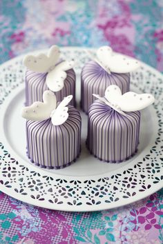 Pretty white butterflies on a purple cake?