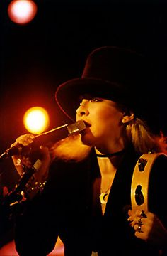 Things to love: Stevie\'s signature square mic and the fact that she always looks like she\'s eating it. Bonus: Tambourine placement and top hat.