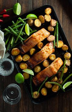 A complete dinner, all made on one baking tray! Oven baked salmon with a chili lime honey glaze, golden roast potatoes and perfectly cooked beans.