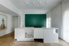 Colourful cabinetry offsets white interior of Bauhaus apartment in Tel Aviv