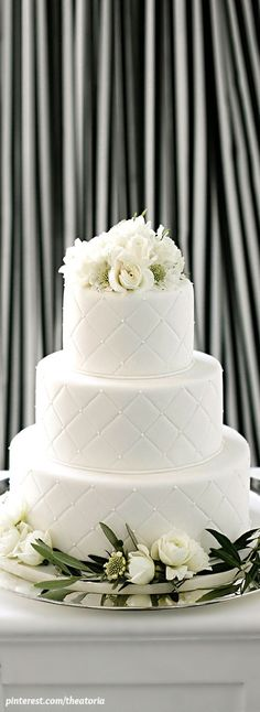 love something like this for the cake... very simple, maybe those thick/shiny leaves from garland and a simple few blooms on top? our cake will be white with little texture, similar to this photo