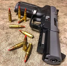 Customized FN 5.7 pistol in sniper grey guns - pistols
