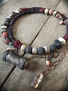 use lava beads with old silver-add red!!! Amulet necklace choker with Tibetan prayerbox, silk, quartz crystal and tribal beads