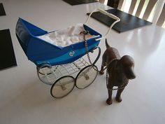 sindy doll pram an dog. I have the baby still who I named Shaky as I was a huge Shakin Stevens fan back then. My pram broke and don't know what happened to the dog.