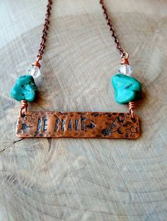 Be Brave hand stamped on textured and aged copper. Copper bar measures 1.5 x. 5 its securely attached to the antique copper chain by wore wrapped faux