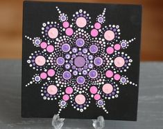 Hand-painted Mandala on a canvas. Painted with high-quality acrylic paints, with a gloss finish for protection. Every dot is hand painted without the use of a stencil or template so no two are alike! Plastic stand in picture not included.