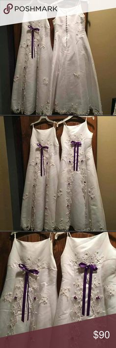EUC GIRLS FULL LENGTH DRESSES AVAILABLE IN 12 &14 These dresses are from David's Bridal they are full length white dresses size 12 and 14 there is purple on them that can be removed then they would be all white I added the purple so they would be able to be removed so you can use the dresses as a solid white or you could do what I did and add different colors or if you'd like I could add colors to them for you perfect for any formal occasion wedding party photo shoot anything baptism David's…