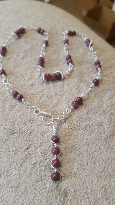 Rubellite wrapped in stirling silver. By Alexis Designs