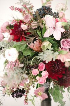 Ruby, pink, lavender, green, and white floral design