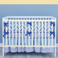 Cute Chevron Baby Bedding Ideas In Baby Rooms : Charming Asher Boys Chevron Baby Bedding with Light Blue Pattern Crib Skirt and Cute Blue Ribbons also White Baby Crib in Pretty Baby Room