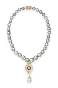 A CULTURED PEARL AND DIAMOND NECKLACE, BY CARTIER Suspending a drop-shaped…