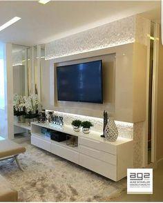 Painel para TV lindo valorizado pela iluminação . Projeto AG2 Arquitetura
