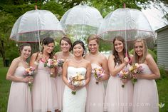 We need to just go ahead and buy matching umbrellas for the bridal party! This shot would be so cute if the groomsmen held the umbrellas for the ladies!   #rainy wedding, rain, bride, umbrella bridal, bridal photography, rainy wedding ideas, rainy day posing, posing in rain, bridal pose, wedding dress, bridal gown, southern wedding, Tennessee wedding, bridesmaids, bridesmaids posing in rain, bridesmaids posing, www.leahbullard.com