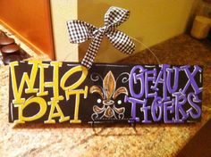 Geaux Tigers / Who Dat - 5x16 Hand Painted Wood Sign with Fleur de Lis - LSU and New Orleans Saints Team Sign.. $33.00, via Etsy.