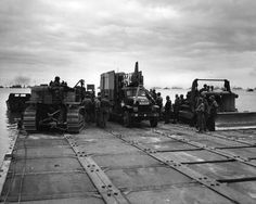Invasion vehicles getting ready to debark from the Seabee Rhino ferry, June Caterpillar D4, Omaha Beach, Normandy Beach, D Day Landings, Battle Tank, Korean War, Armored Vehicles, Us Army, World War Two