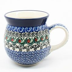 "4"" H x 4"" W x 5 1/2"" L - Quality 1 Guaranteed from the renowned Ceramika Artystyczna Boleslawiec - Polish Pottery is Oven, Microwave, and Dishwasher Safe! - Hand Painted and Stamped by Highly Skilled"