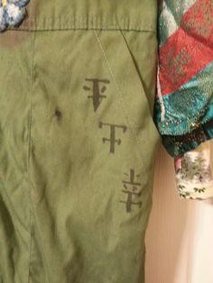 Symbols on left pocket