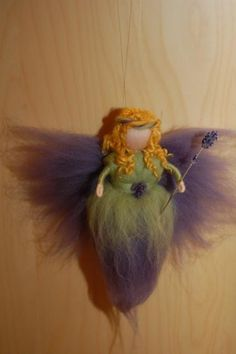 I like this fairies hair and flower in her waist.