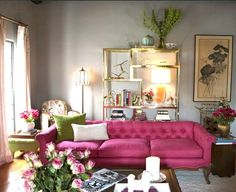 from the decorista insanely divine gold bookshelf open frame hot pink couch and living room love
