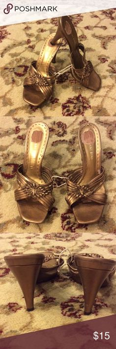 "Ladies Bronze Leather Slip-on Heels These were worn only twice & are in great condition!  Beautiful bronze color with strappy detail & 4"" heel height. Gianni Bini Shoes Heels"