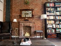 Exposed brick lends an artistic and casual atmosphere to a home decor and design texture. Take a look at options for an exposed brick wall. Brick Interior, Home Interior Design, Interior Walls, Brick Wall Gardens, New York Loft, Decoration Bedroom, Faux Fireplace, Candle Fireplace, Fireplace Bookcase