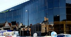Reflections in a building by Charmian S Berry - This is a very large and ahead of its time building in Ipswich with dark smoky glass all round and produces marvelous reflection as I discovered yesterday while stuck in a traffic jam. It is the Wi...