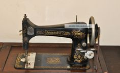 http://ancientpoint.com/imgs/a/g/f/n/s/antique_domestic_treadle_sewing_machine_and_cabinet_with_instructions_3_lgw.jpg