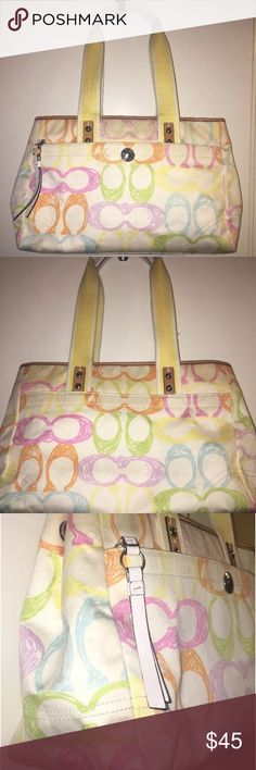"Coach Scribble Signature Canvas Bag Cute Coach Signature ""Scribble"" bag. White canvas with tan and white leather accent trim. Pastel signature scribble in pink, lavender, orange, lime and sky blue. Woven handle is yellow and white with white leather tops. Exterior has front snap pocket, and a couple of areas that would use a bit of cleaning, with slight areas of wear at bottom corners. Interior is goldenrod satin with side zip and accessory pockets, and is in good, mostly clean condition…"