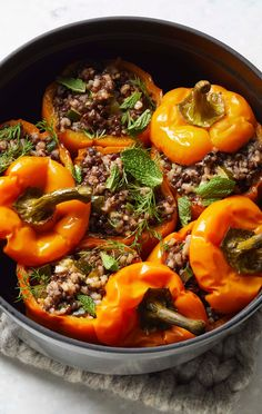 If you like stuffed grape leaves, you'll love the tangy filling for these bell peppers that conjure up daydreams of vacationing on a Greek island. The savory black lentil mixture is studded with sweet raisins and infused with the Mediterranean flavors of mint and dill. The recipe calls for instant brown rice, but you can use any kind. Simply adjust the cooking time and water amounts to the directions on the package. Then get ready to dig in! Herbed Rice, Vegan Stuffed Peppers, Stuffed Grape Leaves, Vegan Casserole, Lentils And Rice, Cooking Courses, Loaded Baked Potatoes, Free Meal Plans, How To Eat Paleo
