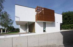 House THE / n-lab architects...going to the garage...
