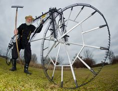 """German bike designer Dieter """"Didi"""" Senft, aka El Diabolo during the Tour de France, presents his latest bicycle invention, the so-called '111-twelve-teeth-rake-bicycle' in Storkow, Germany on March 12, 2012. The bicycle is made of 111 garden rakes. (Patrick Pleul/AFP/Getty Images) #"""
