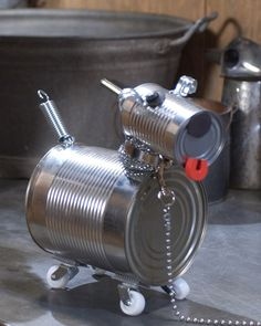 Tin Can Dog. Reuse craft for earth day. Making this tin-can dog is a perfect project for you and your kids to do together. Almost everything you need can be found in your tool chest, kitchen cabinet, and recycling bin. Tin Can Crafts, Metal Crafts, Crafts For Kids, Arts And Crafts, Easy Crafts, Easy Diy, Recycled Tin Cans, Recycled Crafts, Recycled Robot