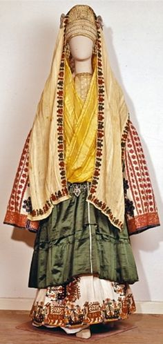 Bridal costume of the Aegean island of Astypalaia. (18th–19th century)  The headdress includes long silk veils and a velvet cap encrusted with pearls and embroidered with gold wire.