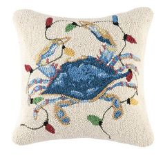 Tangled up in colorful holiday lights, this fun new blue crab Christmas pillow is guaranteed to make you smile!