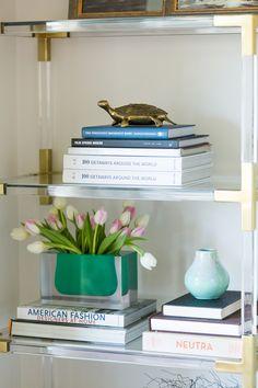 The Jonathan Adler Bel Air Gorge Vase in Emerald featured in Catt Sadler's home on Style Me Pretty. Photography: Dustin Walker for Laurel & Wolf - www.laurelandwolf.com/   Read More on SMP: http://www.stylemepretty.com/living/2017/03/15/peek-inside-the-new-luxe-living-room-of-e-news-catt-sadler/
