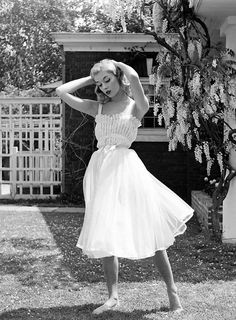 Breezy summer dress Model Vikki Dougan; photo by Nina Leen; May 1952.