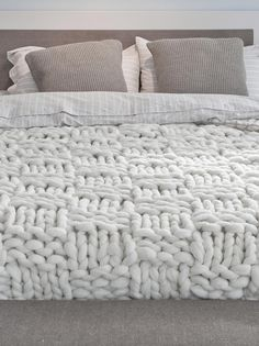 $470,00E Double bed blanket, natural white yarn w/ taupe ribbon (blanket stitch detail along hem) Basket stitch blanket Taupe-Double   Knittingnoodles *I love this ticking linen shams + bed sheets on this bed.  I could make this blanket in about a week b/c it's HUGE needles - like 13 or 15 size needles + super bulky yarn - which they sell as well.  You could also buy this white-ish yarn and dye it to match.  Cute throw as well.