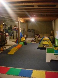 Great example of organizing an unfinished basement/gararge into a playroom virtually no cost with a similar basement layout to ours