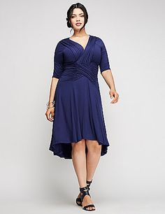 From the surplice neckline, to the ruched waist (with some corset-esque detail) to the subtle high/low hemline, this Kiyonna dress is sure to wow. lanebryant.com