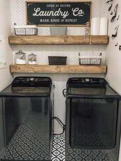 Black appliances farmhouse laundry room diy DIY laundry room with wallpaper, peel and stick tile flooring, diy shelving, and washer and dryer. Modern farmhouse l Pantry Laundry Room, Laundry Room Shelves, Laundry Room Remodel, Laundry Decor, Farmhouse Laundry Room, Small Laundry Rooms, Laundry Room Design, Laundry In Bathroom, Laundry Room Organization