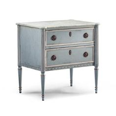 A nonchalant beauty, the Etienne Bedside Chest was inspired by a French antique, with honed Carrera marble top, French blue finish and white edging. Two    spacious drawers with hidden compartment in the bottom one.            Patina French blue finish                White painted edging on drawers                Carrera marble top                Natural finish inside drawers                Dovetailed drawers                Fluted columns                Tapered feet