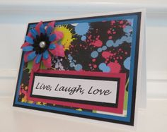 Live Laugh Love inspirational card.  Bright paint-splash paper in black, blue, pink and yellow.