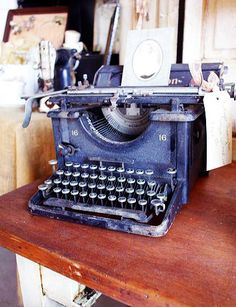 Beautiful old black typewriter.  I love mine.  It sits in my living room.  I think you can see it in my photos.