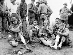 Five Japanese soldiers, part of 20 taken alive during mop-up of Iwo Jima, Japan on June 26, 1945, af... - AP Photo/U.S. Signal Corps