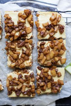 A new take on apple pie! These Gluten Free Apple Crisp Cheesecake Bars are the new dessert favorite! These cheesecake bars are creamy, dreamy, scream fall and the apple crisp topping is to die for! | #ad #UndeniablyDairy @DairyGood