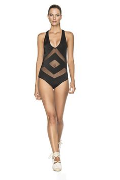We love the mesh cutouts in diamond shapes on the front and the racerback detail on the back. The Latin fit bottom also gives your best asset the perfect shape. This black one piece truly goes above and beyond. #onepiece