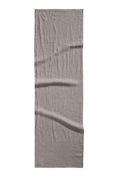 Washed linen table runner: PREMIUM QUALITY. Table runner in washed linen with a small stamp print in one corner. Tumble-drying will help to keep the linen soft.